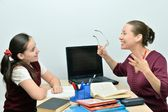 Teacher teaches teen girl — Stock Photo