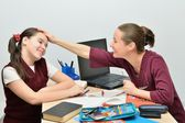Teacher pats on the head and praises good student girl teenager — Stock Photo