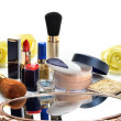 Items for decorative cosmetics, makeup, mirror and flowers — Stock Photo