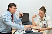 Man and woman doctors at work — Stock Photo