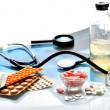 Still life of medical items used by doctors to treat — Stock Photo #42062975