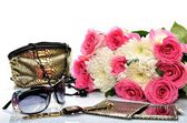 Ladies handbag for cosmetics, accessories, sunglasses, and a bouquet of flowers — Stock Photo