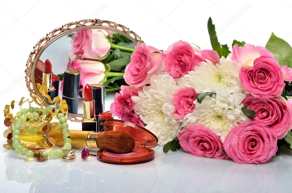 depositphotos_42419807-Womens-jewelry-perfumes-cosmetics-and-a-bouquet-of-flowers-in-still-life.jpg