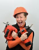 Hilarious joked woman builder with tools in hand — Stok fotoğraf