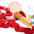 Perfumes and decorative cosmetics still life with red rose petals — Stock Photo
