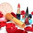 Scarlet rose petals and women's decorative cosmetics, perfume in still life — Stock Photo