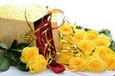 Bouquet of yellow roses and gift box with lacy thing inside — Stock Photo