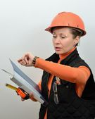 Of construction foreman woman looks at the clock — Stock Photo