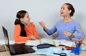 Teacher woman very with enthusiasm tells pupil girl theme lesson — Stock Photo