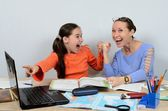The teacher is a woman and a student rejoice at the success in training on computer — Stock Photo
