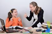 Teenage schoolgirl rejoices a good assessment from the teacher — Stock Photo