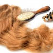Artificial hair and accessories: comb, barrette for women hairstyles in still life — Stock Photo