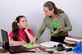 Teacher teaches teen girl — Stock Photo