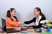 Schoolmarm congratulated apprentice, shaking her hand with successful execution of tasks — Stock Photo