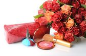 Decorative cosmetics and perfumes subject against a beautiful bouquet of flowers — Stock Photo