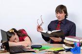 Teen schoolgirl tired and asleep when the teacher reads the book. — Stock Photo