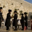 Stock Photo: Orthodox Jews by Western Wall in Jerusalem, Israel