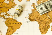 Love to travel. Map of the world. Money. — Stock Photo