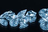 Diamonds on black background with reflection — Stock Photo