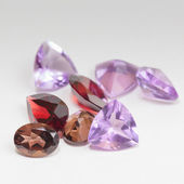 Colorful gemstones with garnet stone — Stock Photo