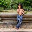 A boy of relaxed posture at Angkor wat Temple. (Leisurely boy) — Stock Photo