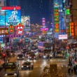 Hong Kong, China - March 16, 2013: Street Scene in Mongkok. Colorful shopping street Illuminated at night. Mongkok is a district in Hong Kong and has the highest population density in the world — Stock Photo #36433967