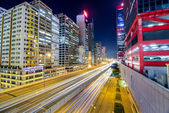 Night traffic with long shutter at Sheung Wan Car Park. Hong Kong is a 24 hours living city. — Stock Photo