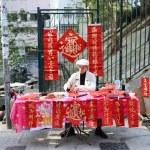 Writing Chinese New Year antithetical couplets — Stock Photo
