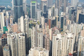 Hong Kong, China - February 22, 2014: skyscrapers and residential buildings in Hong Kong. The city is one of the most populated areas in the world. — Stock Photo