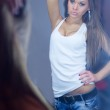 Reflection of a beautiful girl in the mirror — Stock Photo