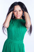 Pretty girl in a green dress — Stok fotoğraf