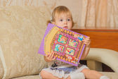 A little girl holding a book — Stock Photo