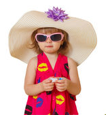 Little girl in a hat and glasses — Stockfoto