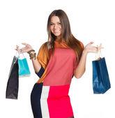 Beautiful girl in a dress shopping hands — Stock Photo