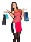 Ragazza bellissima in un abito shopping mani — Foto Stock
