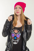 A young girl in a hat and a leather jacket  — Foto de Stock