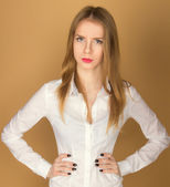 A beautiful young girl in a white shirt — Stock Photo