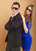 Beautiful guy and girl in business clothes  — Stock Photo