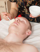 Girl masseuse doing massage — Stock Photo