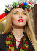 Beautiful girl in Ukrainian national dress posing — Stock Photo