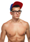 Athletic guy in glasses and a cap — Stock Photo