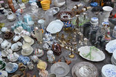 Old dishware on a flea market — Stock Photo