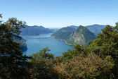 Lugano, Switzerland - Juli 31, 2014: Images of the Gulf of Lugano from Monte Bre above the City. — Stock Photo