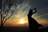 Woman watching at the sunset — Foto Stock