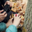Children taking photos to autumn leaves — Stock Photo #38515755