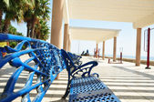 Blue bench at the sea — Stockfoto