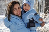 Winter portrait of mother and baby boy — Stock Photo