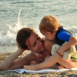 Mother with her baby on the beach — Stock Photo #38894751