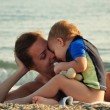 Mother with her baby on the beach — Stock Photo #38894753