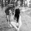 Little horse and brunette girl in the forest — Stock Photo